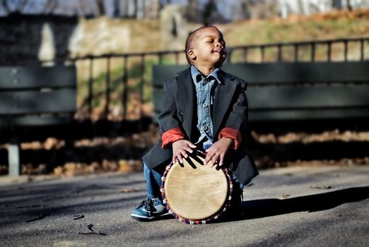 Toumani, who was born in Mali, plays his djembe drum in his new home: the Bronx.