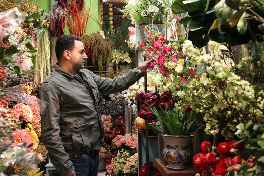 A man considers a flower at Pany Silk Flowers.