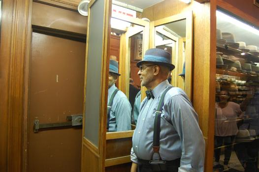 Rod Springer standing in the three-way mirror