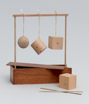 Froebel Gift No. 2: Sphere, Cylinder, and Cube. c. 1890.