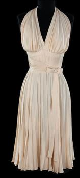 She wore the ivory rayon-acetate halter dress with pleated skirt in 1955.