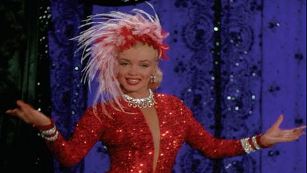 "Marilyn Monroe wore this signature red-sequined showgirl gown with a feathered hat in the number ""Two Little Girls from Little Rock"" in ""Gentlemen Prefer Blondes."""