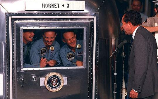 President Nixon visits the returned astronauts in quarantine. (NASA)