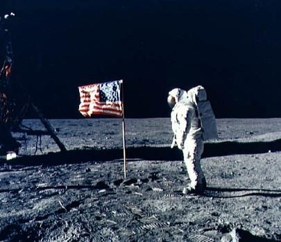 Buzz Aldrin salutes the U.S. Flag. (NASA)