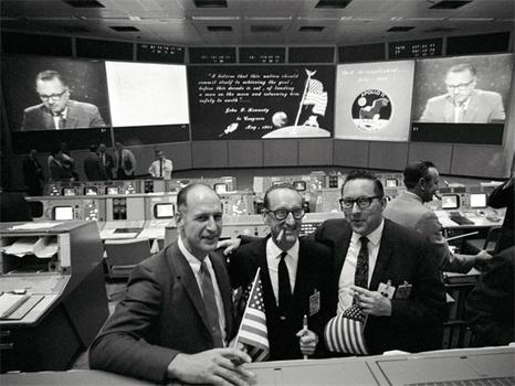 NASA staff celebrate in Mission Control. (NASA)