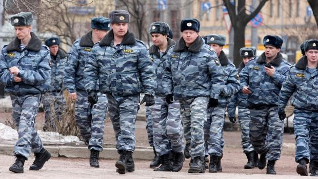 A group of Russian police patrols outside Moscow's Lubyanka Metro station