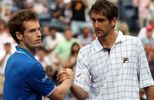 Marin Cilic of Croatia (R) shakes hands with Andy Murray.