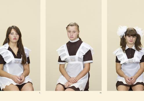 MoMA is displaying part of an intense photographic series by Taryn Simon -- pieces that examine individuals tied to a specific bloodline. Seen here: students from the Ukraine.