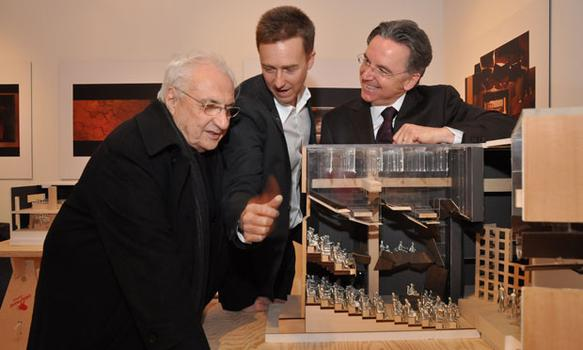 Architect Frank Gehry, Signature Capital Campaign Chair and Board Member Edward Norton and Signature Founding Director James Houghton check out one of the center's model.