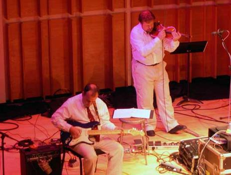<strong>Composer Phil Kline and violinist Todd Reynolds perform Zippo Songs, 9/28/04.</strong>