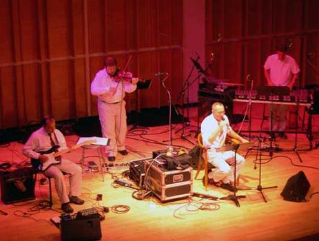 <strong>The Zippo Band. Phil Kline, guitar; Todd Reynolds, violin; Theo Bleckmann, vocals; and David Cossin, percussion. Merkin Hall, 9/28/04.</strong>