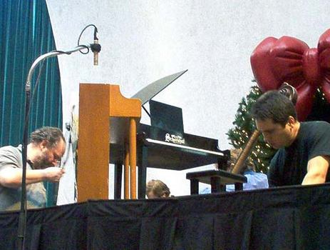 <strong>Far left: Senior Concert Engineer Ed Haber sets up the microphone on the toy piano, 12/9/03.</strong>