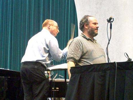 <strong>Aaron Jay Kernis (L) runs the piece, while engineer Ed Haber (R) checks microphone placement, 12/9/03.</strong>