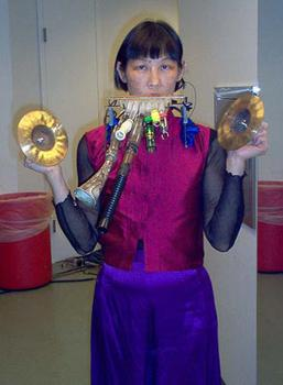 <strong>Soloist Margaret Leng Tan, resplendent in purple and magenta, 12/9/03.</strong>