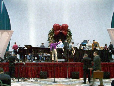 <strong>Margaret Leng Tan (center, in purple) looks over the score with Aaron Jay Kernis as Alarm Will Sound sets up, 12/9/03.</strong>