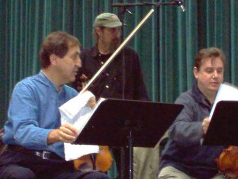<strong>Members of The Chilingirian String Quartet discuss the Tavener commission, while a sound technician hovers, 10/23/03. </strong>