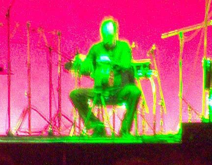 "<strong>Percussionist Steven Schick (with psychedelic coloring) performs on air raid siren, from a section of John Luther Adams'  ""The Mathematics of Resonant Bodies,"" 11/20/03.</strong>"