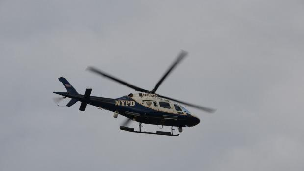 A NYPD chopper hovered over Eastern Parkway.