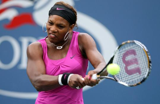 Serena Williams returns a shot against Alexa Glatch.