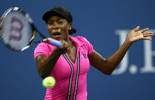 Venus Williams returns a shot against Vera Dushevina.
