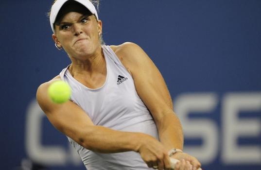 Melanie Oudin returns a point to Caroline Wozniacki.