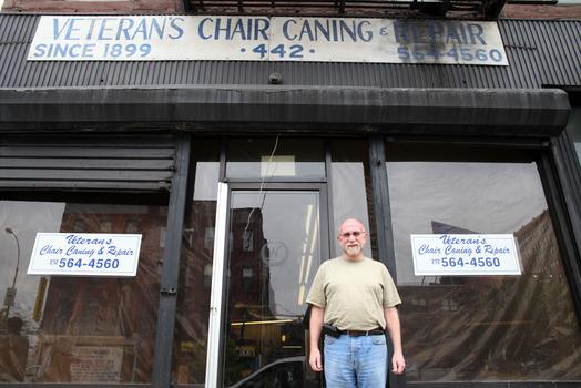 John Bausert outside his shop.