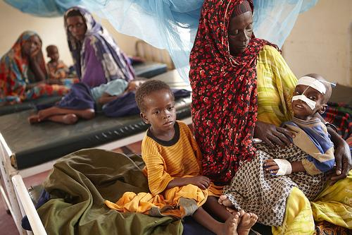 Luli Hassan Ali looks after her two children in a clinic near Dadaab.