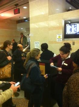 Delayed riders crowded the NJ Transit Info Desk at Penn Station.