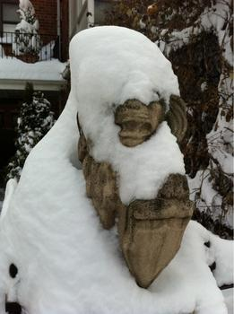 This gargoyle also in Astoria, Queens, got dusted with snow on Thursday.