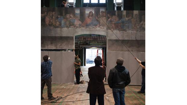 "In-process installation photography of ""Leonardo's last Supper: A Vision By Peter Greenaway."""