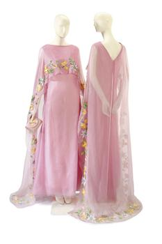 Two Christian Dior pink chiffon and Raffia embroidered evening gowns from 1968 will also be sold at auction.