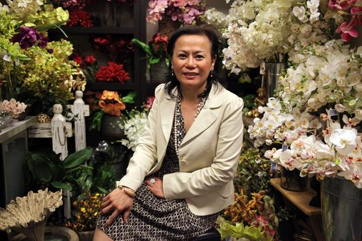 Mimi Rasamee, owner of Pany Silk Flowers in her orchid room.