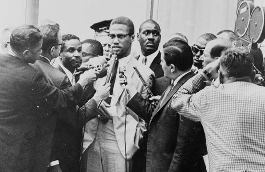 Malcolm X at a 1964 press conference.