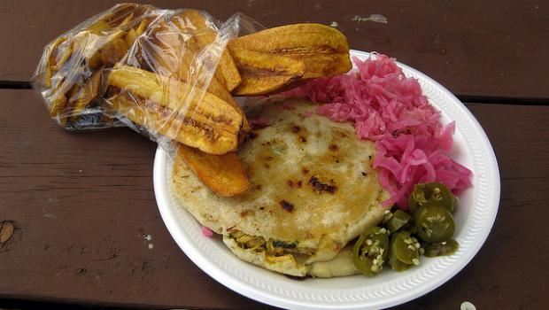 Across the street from Red Hook Pool delicious eats like this pupusa and plantains can be found.