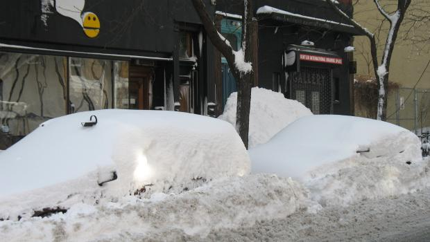 Thursday's snow storm blanketed cars with snow.