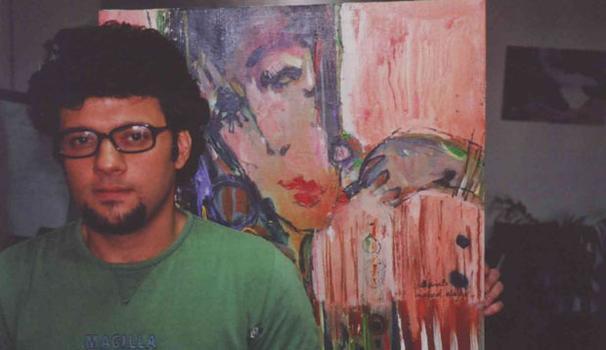 Iraqi Artist and Refugee Mohammad Alaqbar alongside his work.
