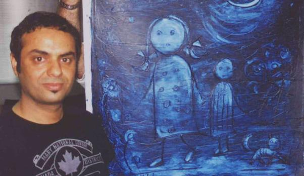Iraqi Artist and Refugee Mauyyad Khaled in front of his work.