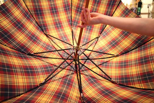 An umbrella with wooden ribs.