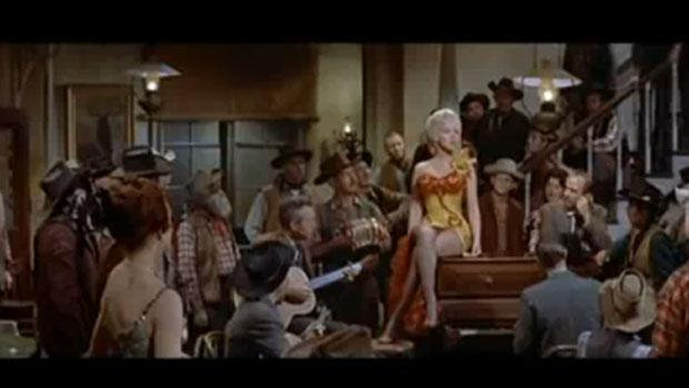 "Monroe in a gold charmeuse saloon-girl Travilla gown in the 1954 film ""River of No Return."""