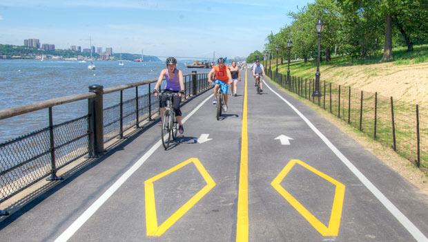 At Riverside Park, bikers are surrounded by the scenes of New York City.