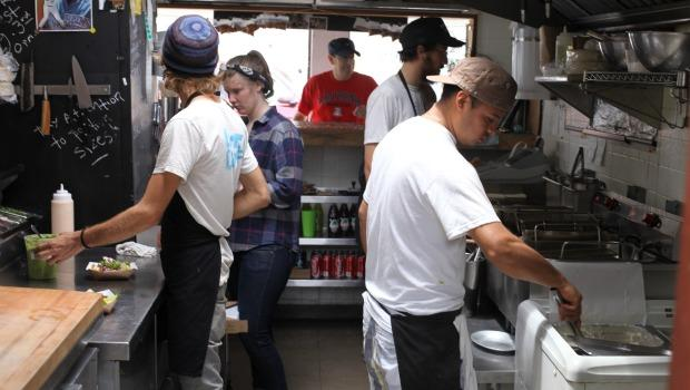 The Rockaway Taco team fixes up some flautas at its 96th St. stand.