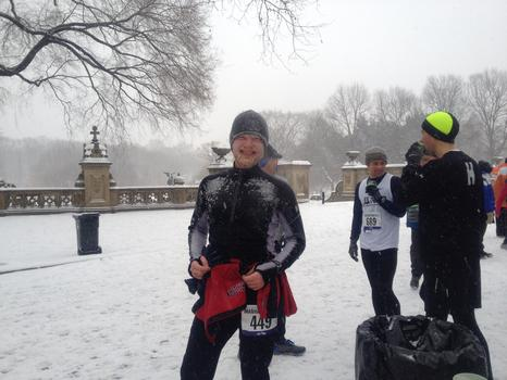 A runner covered in snow and ice.