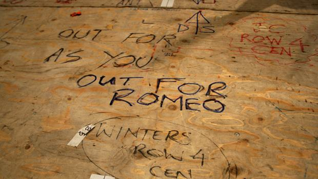 "Markings on the sub-floor of the stage like ""OUT FOR ROMEO"" show where to place custom pieces for each performance."