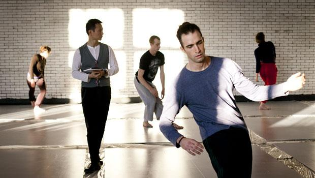 """In this shot, Shen Wei in rehearsal with his company's dancers for his new world premiere of """"Undivided Divided."""""""