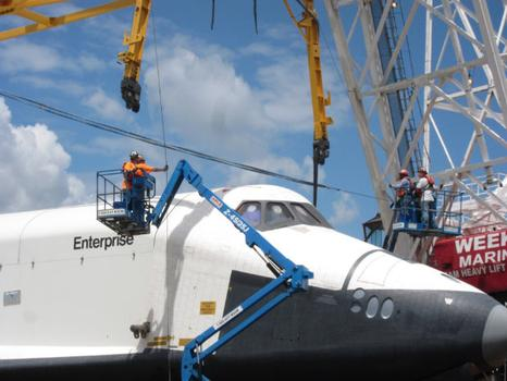 The crane is attached to the shuttle.