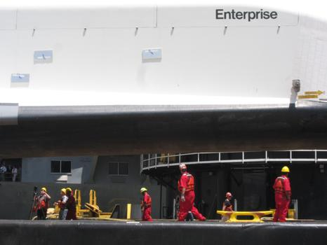 Workers prepare to move the shuttle.
