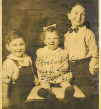 Leonard (right) with his brother and sister.
