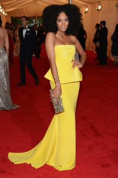 Singer Solange Knowles also wore yellow to the Met gala. Her jewelry is by Jennifer Fisher.