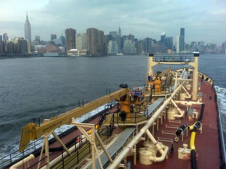 Trucking up the East River with a load o\' sludge.