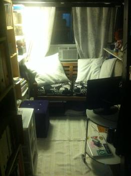 A close-up of the living space under her lofted bed.